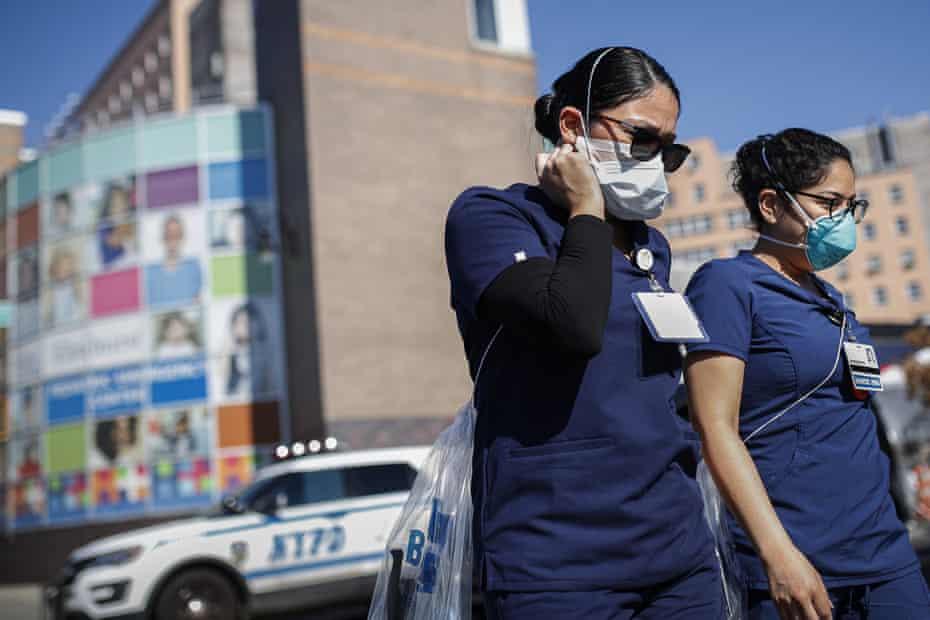 Nurses leave Elmhurst hospital in New York on 27 March.