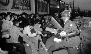Tokyo riot police attempt to take a student demonstrator into custody in Shinjuku, October 1969.