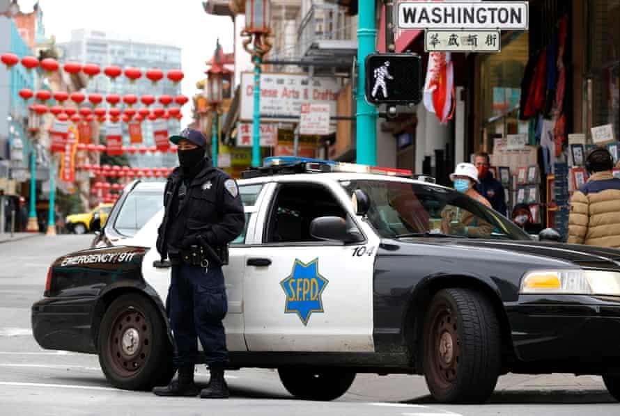 San Francisco police patrol the Chinatown neighborhood on 18 March.