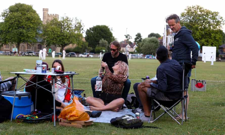 people having a picnic on Twickenham Green in June