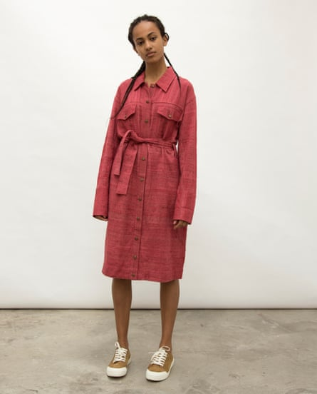 An Indian model wearing a red shirt dress with a tie around the waist