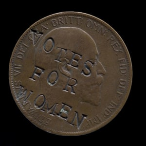 An Edwardian coin defaced by a suffragette with the 'votes for women' slogan.