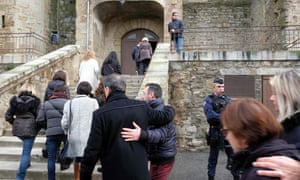 Mourners arrive at the Saint Etienne church in Trèbes for a service of remembrance.
