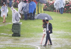 Melbourne, AustraliaA general view is seen as racegoers walk in puddles as rain tumbles down after race 1 the Ottawa Stakes during Melbourne Cup Day at Flemington Racecourse