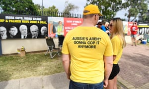 United Australia party volunteers outside a polling booth in Townsville