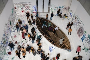Leipzig, Germany: Visitors view the work 'Add colour painting (Refugee boat)' by artist Yoko Ono
