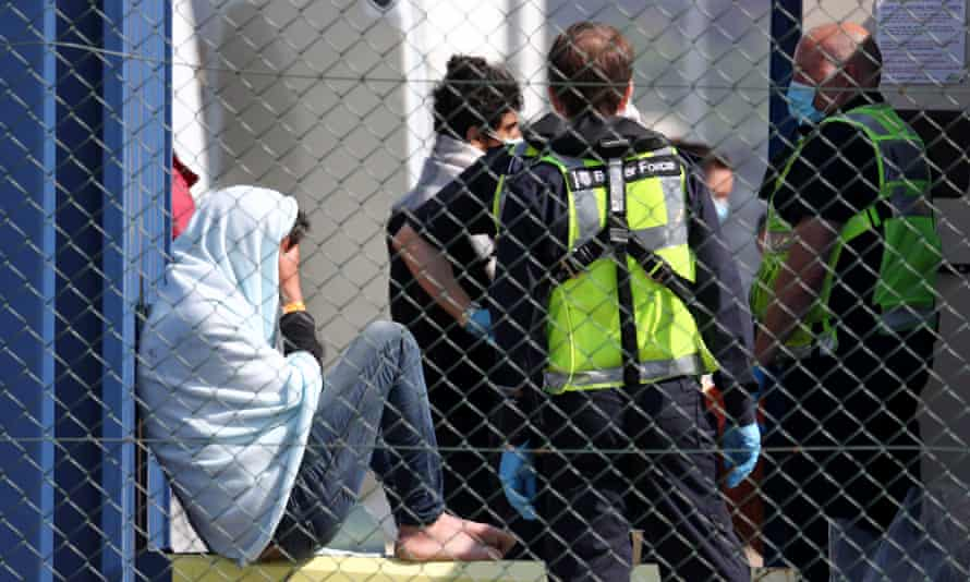 A man being processed by Border Force officials in Dover