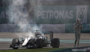 Sepang, Malaysia: Mercedes driver Lewis Hamilton walks from his car after an engine failure during the Malaysian Formula One Grand Prix