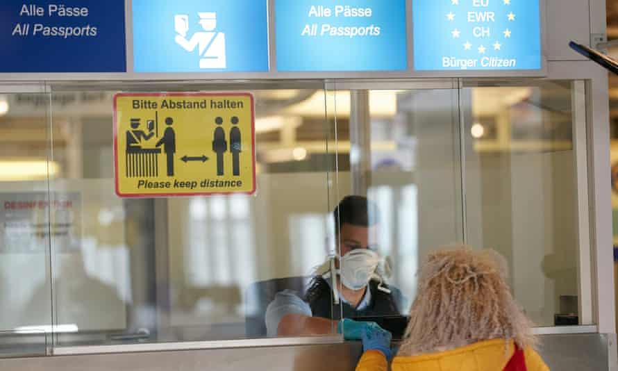 A Romanian woman arrives at Frankfurt airport last year for seasonal farm work in Germany, which has tightened rules on subcontracting in meat plants.