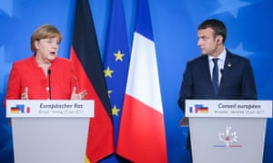 Angela Merkel and Emmanuel Macron hold a joint press conference at the end of the European council summit in Brussels.