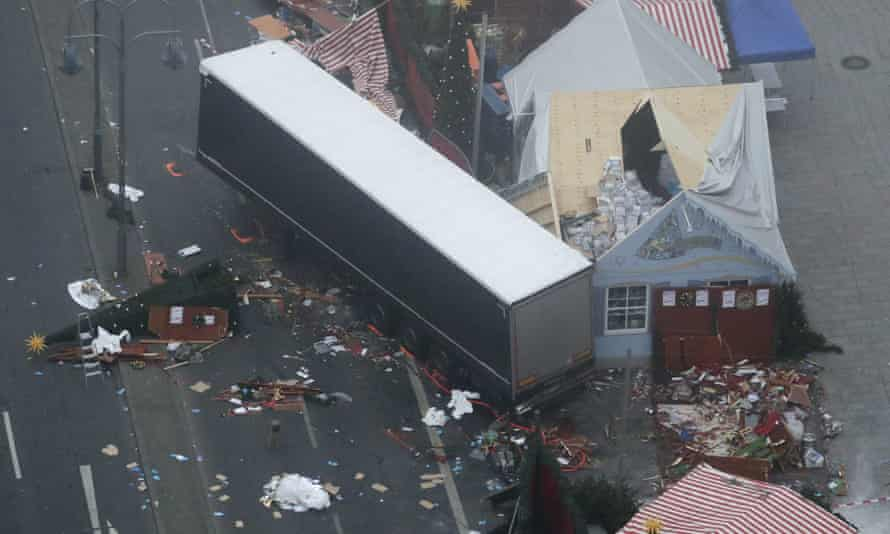The trailer of a truck stands beside destroyed Christmas market huts in Berlin