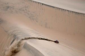 Honda's Jose Ignacio Florimo Cornejo pulls away after successfully climbing a dune
