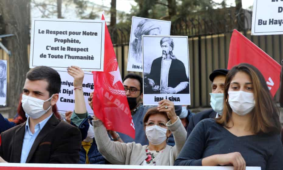 Demonstrators outside the French embassy  in Ankara. A sign reads 'Respect for our prophet is respect for all mankind.