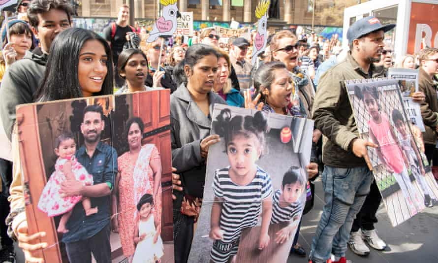 Supporters of Tamil asylum seekers Nadesalingam, Priya and their Australian-born children Kopika and Tharunicaa are seen at a rally in Melbourne in September 2019.