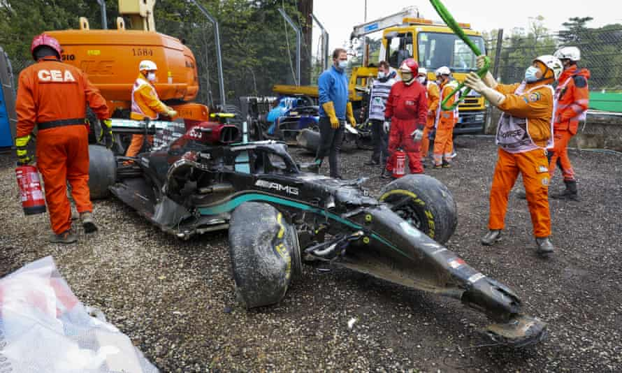 Trackside workers clear the Mercedes of Valtteri Bottas after the Finn's crash with George Russell at the Emilia Romagna F1 Grand Prix