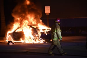 Cars include police cars were set on fire, as protests escalated after a Black Lives Matter protest