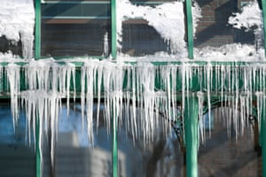 Sub-zero temperatures produce icicles that hang from a restaurant in Minneapolis