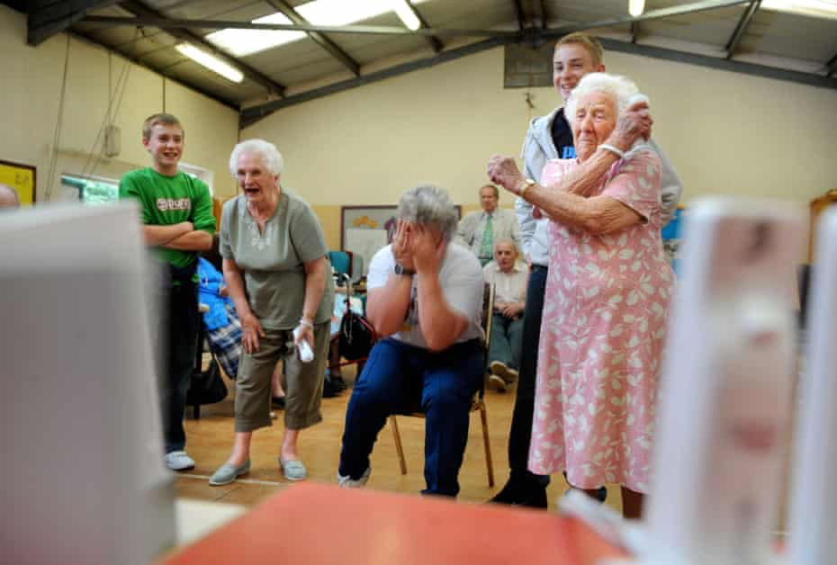 Elderly esidents playing Nintendo in a care home
