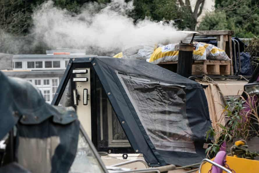 Smoke from a wood burning stove on a London barge. According to a recent report wood burners can triple the level of harmful pollution particles inside homes.