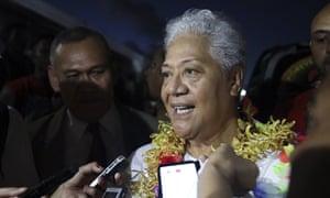 Samoa's Prime Minister-elect Fiame Naomi Mata'afa talks to reporters outside parliament house in Apia, Samoa, on Monday 24 May 24