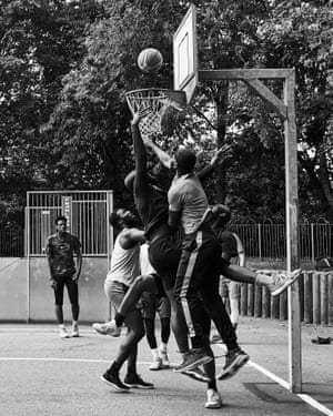 A player fights hard to reach the basket