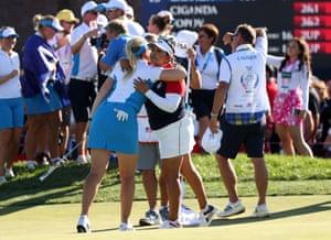 Matilda Castren of Team Europe hugs Lizette Salas of Team USA on the 18th hole after winning.