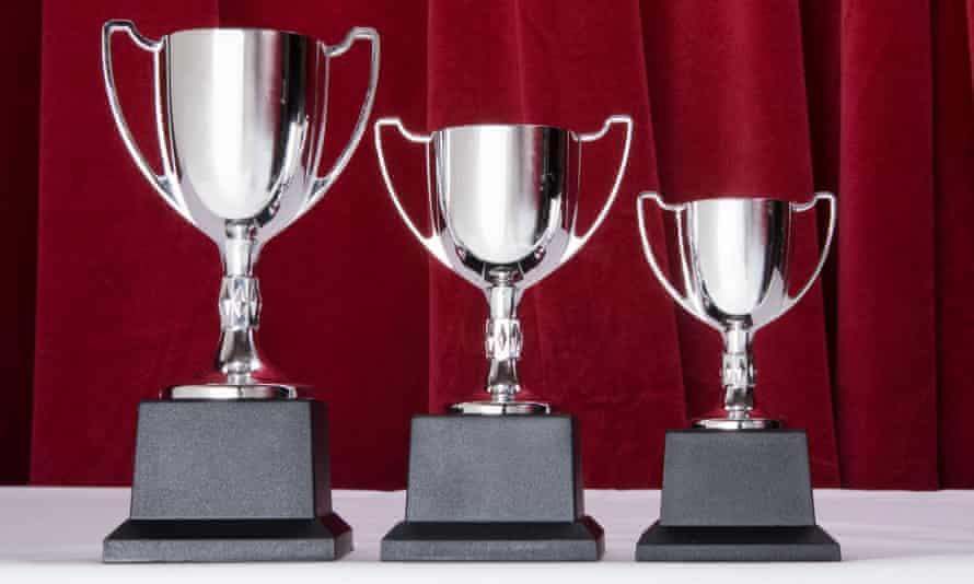 three silver trophies.
