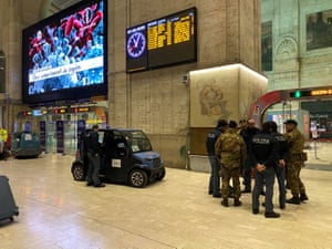 Military and policemen are seen inside Milan's main train station as Italian authorities prepare to lock down Lombardy to prevent the spread of the highly infectious coronavirus.