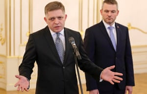 Outgoing prime minister Robert Fico addresses the media after tendering his resignation, while his successor Peter Pellegrini looks on.
