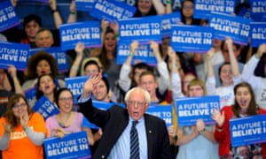 Sanders waves to the crowd as he takes the stage at a campaign rally at Cornell college in Mount Vernon, Iowa.