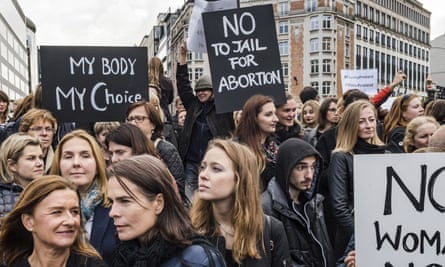 Polish women protest against a legislative proposal for a total ban on abortion in Poland, during a demonstration near EU headquarters in Brussels, Monday, Oct. 3, 2016.