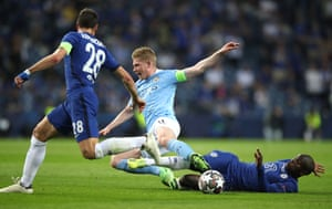In the second half, Kevin De Bruyne of Manchester City is tackled with expert precision by N'Golo Kante of Chelsea. You won't see a finer slide-tackle than that.