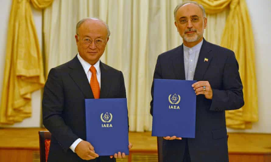 The IAEA's director general, Yukiya Amano, with Iran's representative Ali Akbar Salehi, right, in Vienna.