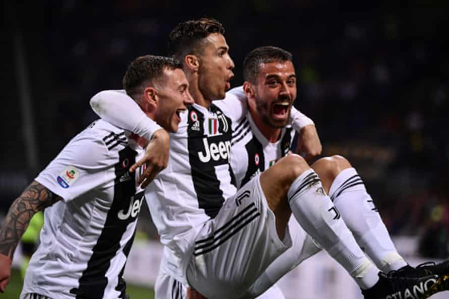 Cristiano Ronaldo is carried aloft in celebration by his Juventus teammates after his landmark goal.