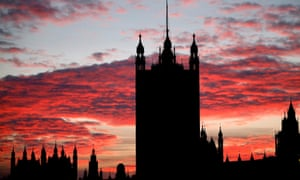 The sun setting behind the Victoria Tower at the Palace of Westminster in London this afternoon.