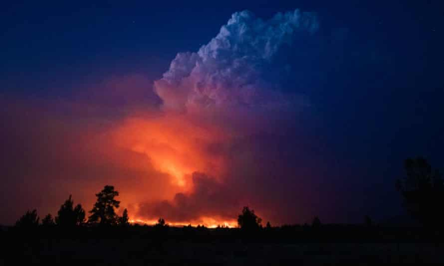 Flames and smoke rise from the Bootleg fire in southern Oregon on 14 July.