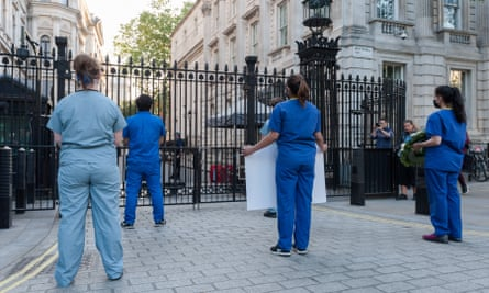 NHS staff staging a silent protest outside Downing Street in May.