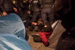 The police remove tents to clear the Place de la Republique