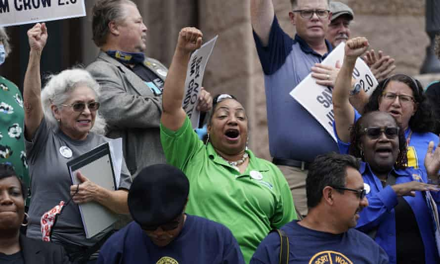 Demonstrators join a rally to protest against voting restrictions on the steps of the Texas capitol on Tuesday.