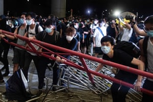 Protesters block the protest area outside the Legislative Council with barricades