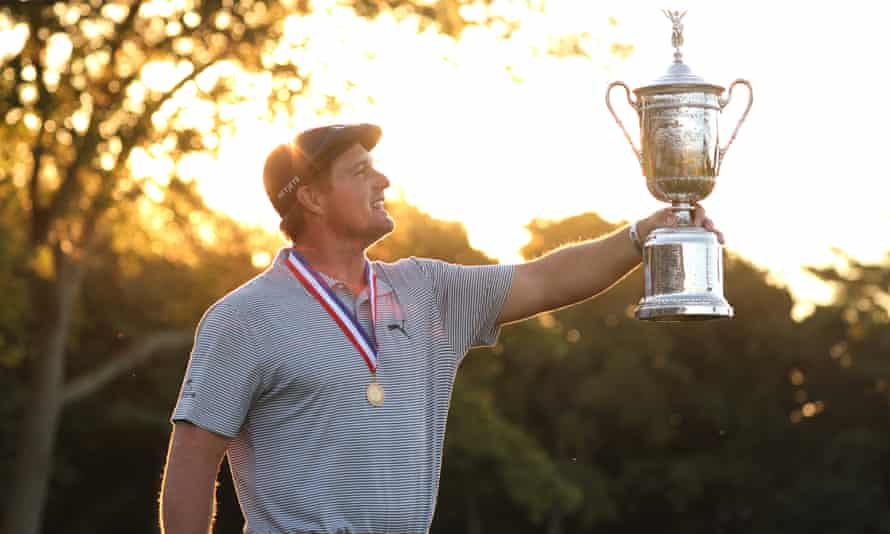 DeChambeau with the championship trophy after winning the 2020 US Open at Winged Foot.