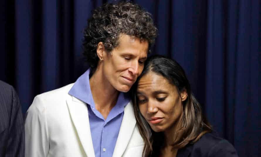 Andrea Constand embraces prosecutor Kristen Feden during a news conference after Cosby was found guilty in 2018.