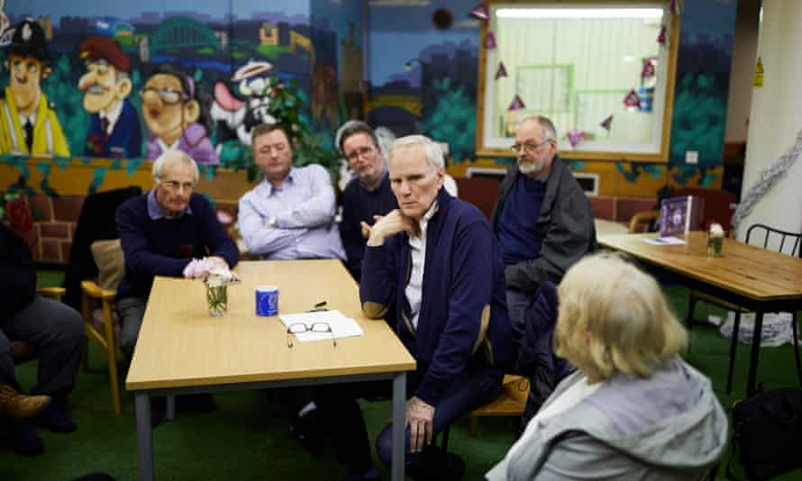 Philip Alston (C) at the Cedarwood Trust community development charity in North Shields during his tour of the UK.