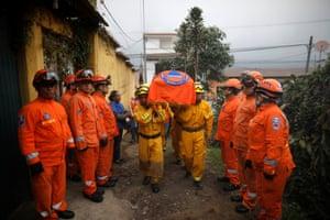 Alotenango, Guatemala Rescuers carry the coffin of Juan Fernando Galindo