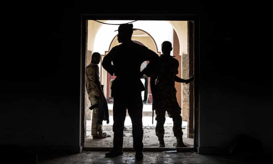 Nigerian troops inspect the former emir's palace that was used by Boko Haram, in Bama