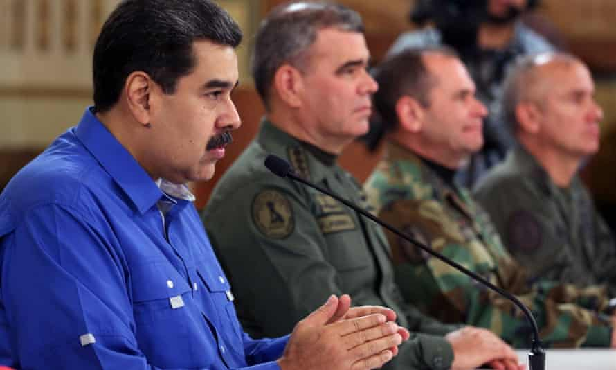 Venezuela's president Nicolas Maduro at the Miraflores palace next to defence minister Vladimir Padrino in Caracas, on Tuesday.
