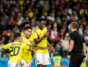 Colombia's Yerry Mina, Radamel Falcao and Juan Fernando Quintero confront referee Mark Geiger during the round of 16 match against England at Spartak Stadium.
