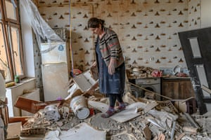 Xatire Celilova walks in the kitchen of her destroyed flat following a ceasefire during a military conflict between Armenia and Azerbaijan over the breakaway region of Nagorno-Karabakh