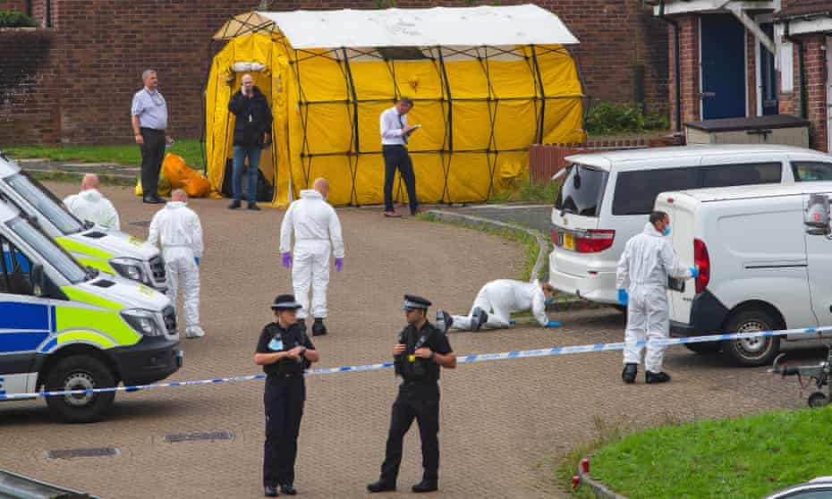 Police officers and forensics at the scene in Plymouth, Devon.