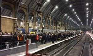 Crowds wait for a train at King's Cross Station in London.